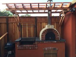 a great combination of an argentine grill and a wood fired outdoor
