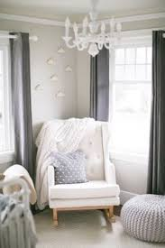 gray nursery daybed with baby animals photographs transitional