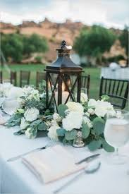 chesters flowers vintage lantern wedding centerpiece surrounded by white