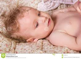 Bed Eyes Cute Blonde Baby With Beautiful Blue Eyes Lying On Bed With