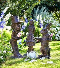 white rabbit garden statue in garden statues white