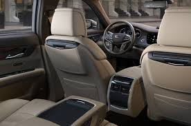 luxury minivan interior the feud lives on cadillac and lincoln