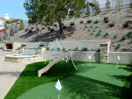 modern landscape and yard with exterior stone floors by rue group
