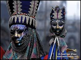 photos of venice carnival fancy masks and extravagant costumes