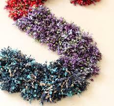 get crafty with yarn pom pom wall art ritzy parties