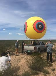 artists bisect the us mexico border fence with balloons