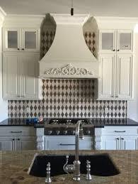Harlequin Backsplash - carerra marble dale tile in a harlequin shape kitchen