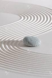 japanese zen garden with stone in raked white sand stock photo