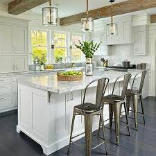 another view of this gorgeous gray kitchen wood beams light