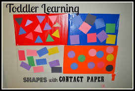 toddler learning activity with contact paper play box