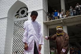 A public whipping outside a mosque in Banda Aceh in       Credit Chaideer Mahyuddin Agence France Presse     Getty Images The New York Times