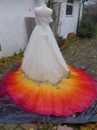 designer pours dazzling dyes on white wedding gown u2014and the result