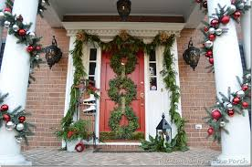 porch decorated for with three wreaths on door and