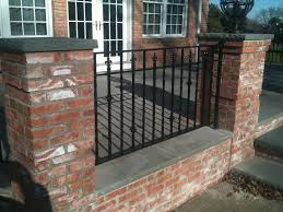 iron deck railings in between brick wrought iron deck railings