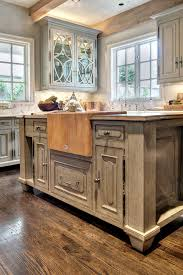 kitchen cabinets that look like furniture the custom island in the kitchen features a butcher block a