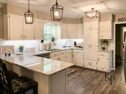 what color kitchen cabinets go with agreeable gray walls kitchen cabinets in alabaster painted by payne