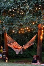 outdoor tree lights for summer add patio lights over your hammock so you can sway in the summer