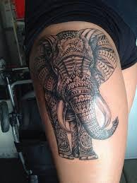 polynesian elephant tattoo on side thigh