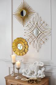 an arrangement of handcrafted mini mirrors from pier 1 makes a