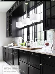 love the black cabinets with white granite counters places and