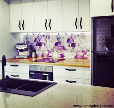our colourful geometric kitchen splashback under lights wallpaper