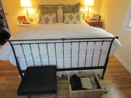 timeless black wrought iron canopy bed with unique footboard and f