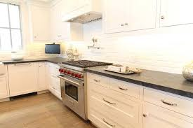 brick backsplash kitchen white and black kitchen with white exposed brick backsplash
