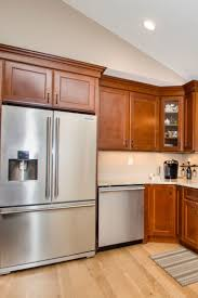 oak kitchen cabinets with stainless steel appliances hanson kitchen gallery glass front cabinets wood cabinets