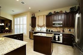 light granite countertops with dark cabinets warm the kitchen with dark cabinets light countertops modern