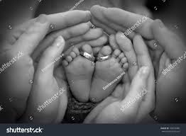 baby hand rings images Closeup of parents hands holding newborn baby feet with wedding jpg