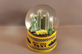 new york city yellow taxi statue of liberty snow globe new york