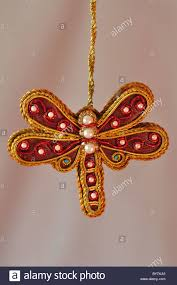 an embroidered dragonfly christmas decoration for the tree with a