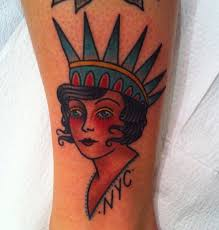 traditional simple woman with a crown tattoo traditional tattoos