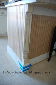 turn any style of cabinets into shaker style with this thin board updating a kitchen island pre primed mdf bead board panels half newel posts for detailing banisters on stairways a piece of primed mdf as a