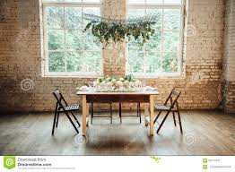wedding room decorated loft style with a table and accessories wedding room decorated loft style with a table and accessories stock photo