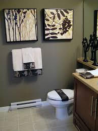 effective bathroom decorating ideas affordable budget tiny bathroom dark color decorated with contemporary arts the wall and modern scluptures