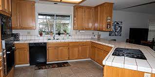 are brown kitchen cabinets outdated style tips for grey kitchen cabinets granite transformations
