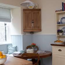 photo trendy corner kitchen cabinet storage crockery unit design