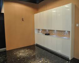 witching white color high gloss kitchen cabinets features built in