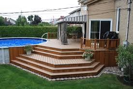 Backyard Deck Design Ideas Ground Level Has A Symmetrical Look - Backyard deck design ideas