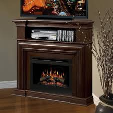 corner light brown wooden fireplace with shelf above also tv on