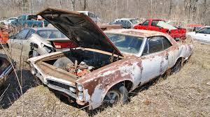 car yard junkyard michigan junkyard turns up some buried muscle car treasure