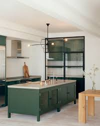 dark green kitchen cabinets bored of white kitchens discover the cabinet color trending now
