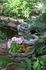 Fountains For Home Decor Landscape Stoned Fountain Configuration With Some Flowers And