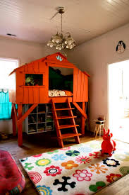 bedroom tree house design for the kids with orange base color and