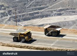 two monster dump trucks pass each stock photo 34950373 shutterstock