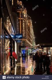 a rainy night in knightsbridge around harrods lit up with
