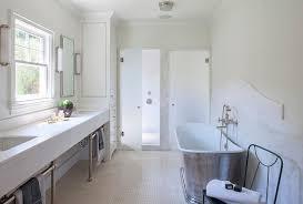 Cast Iron Bathtub With Curved Marble Backsplash Transitional - Bathtub backsplash