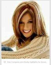 layered highlighted hair styles long hair styles with mohagany and blone chunky highlights hair