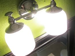 Bathroom Light Fixtures With Outlet How To Replace Bathroom Light Fixture Tos Diy Fixtures With
